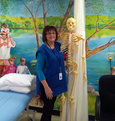 woman standing beside skeleton